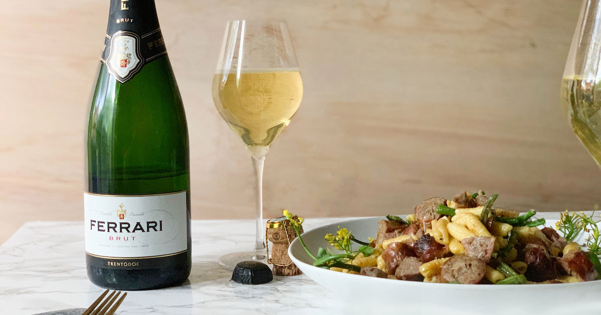 Ferrari Trento Brut and cavatellis with sausages and choy sum